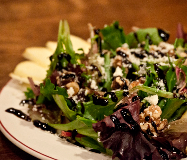 Rocking Frog serves Mixed Green salads with Tomato, red onion, shredded carrots, gorgonzola or cheddar and balsamic glaze.